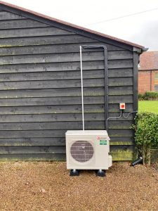 air-con unit next to shed
